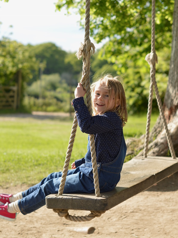 swinging in the gardens at the pig hotel, brockenhurst