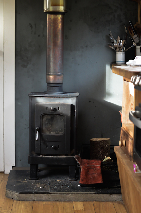 The log burner will keep you warm & toasty, whatever the season outside the Pilot Panther, a converted showman's wagon at the Monachyle Mhor Hotel, part of the Canopy & Stars Collective